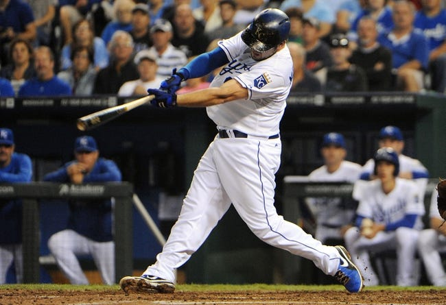 Sep 17, 2013; Kansas City, MO, USA; Kansas City Royals third baseman Mike Moustakas (8) drives in a run with a double in the third inning against the Cleveland Indians at Kauffman Stadium. Mandatory Credit: John Rieger-USA TODAY Sports