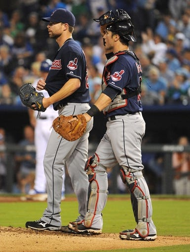Sep 17, 2013; Kansas City, MO, USA; Cleveland Indians starting pitcher Corey Kluber (28) talks to catcher Yan Gomes (10) during the game against the Kansas City Royals in the third inning at Kauffman Stadium. Mandatory Credit: John Rieger-USA TODAY Sports