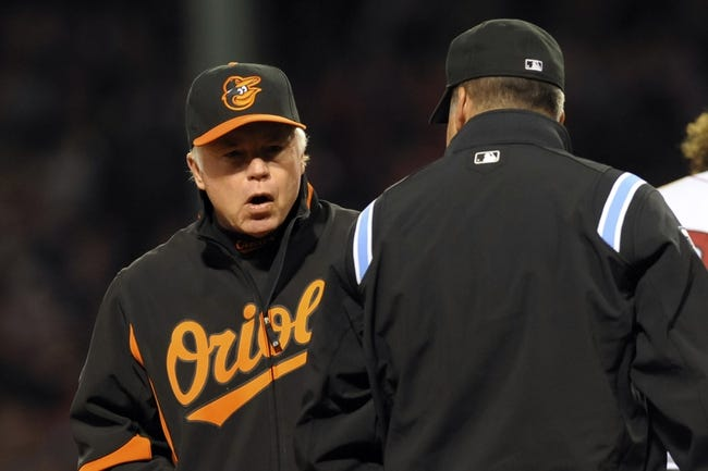 Sep 17, 2013; Boston, MA, USA; Baltimore Orioles manager Buck Showalter (26) argues a call with third base umpire Tim Timmons during the fourth inning against the Boston Red Sox at Fenway Park. Mandatory Credit: Bob DeChiara-USA TODAY Sports