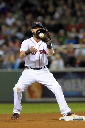 Sep 17, 2013; Boston, MA, USA; Boston Red Sox second baseman Dustin Pedroia (15) gets set to turn a double play during the sixth inning against the Baltimore Orioles at Fenway Park. Mandatory Credit: Bob DeChiara-USA TODAY Sports