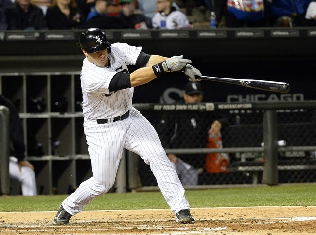 Sep 17, 2013; Chicago, IL, USA; Chicago White Sox catcher Josh Phegley (36) hits a single against the Minnesota Twins during the second inning at U.S Cellular Field. Mandatory Credit: Mike DiNovo-USA TODAY Sports