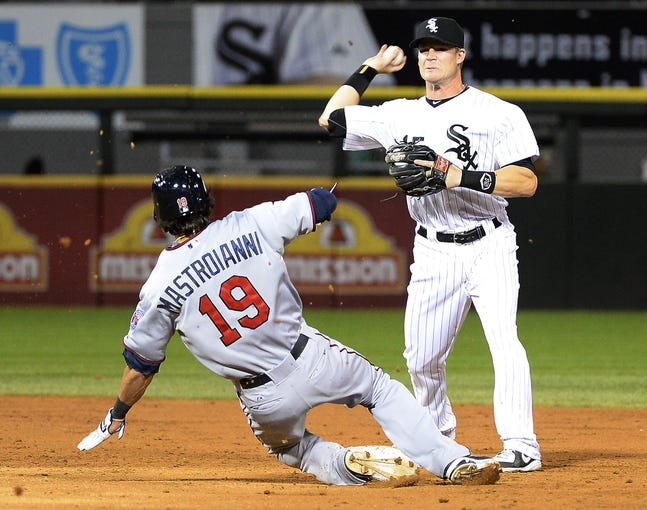 Sep 17, 2013; Chicago, IL, USA; Minnesota Twins center fielder Darin Mastroianni (19) breaks ups the double play on Chicago White Sox second baseman Gordon Beckham (15) during the third inning at U.S Cellular Field. Mandatory Credit: Mike DiNovo-USA TODAY Sports