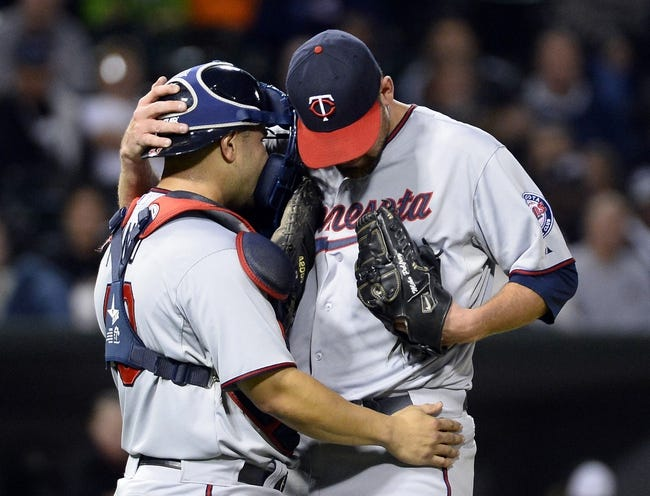 Sep 17, 2013; Chicago, IL, USA; Minnesota Twins catcher Josmil Pinto (43) talks with starting pitcher Mike Pelfrey (37) during the second inning at U.S Cellular Field. Mandatory Credit: Mike DiNovo-USA TODAY Sports
