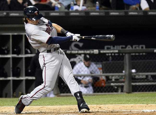 Sep 17, 2013; Chicago, IL, USA; Minnesota Twins center fielder Darin Mastroianni (19) hits a single against the Chicago White Sox during the third inning at U.S Cellular Field. Mandatory Credit: Mike DiNovo-USA TODAY Sports