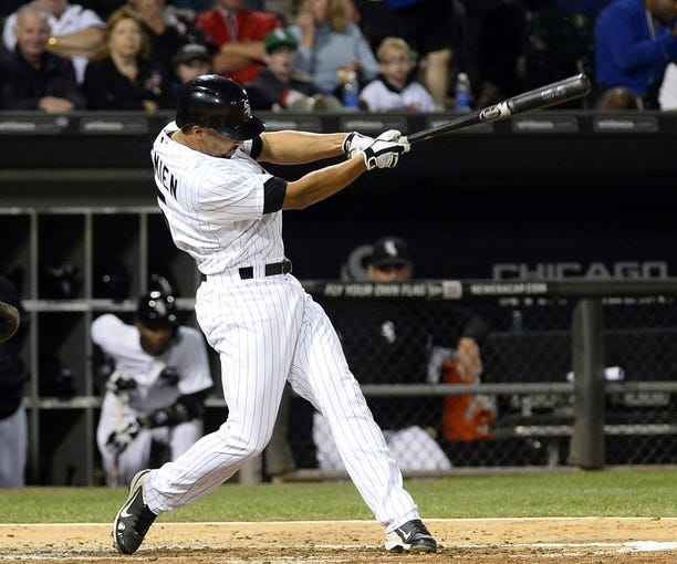 Sep 17, 2013; Chicago, IL, USA; Chicago White Sox shortstop Marcus Semien (5) hits a RBI single against the Minnesota Twins during the second inning at U.S Cellular Field. Mandatory Credit: Mike DiNovo-USA TODAY Sports
