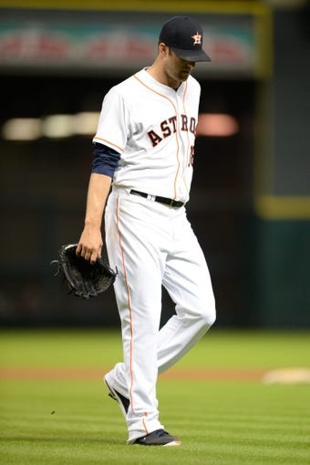 Sep 17, 2013; Houston, TX, USA; Houston Astros starting pitcher Jordan Lyles (18) walks to the dugout after giving up nine runs in 3 1/3 innings against the Cincinnati Reds during the fourth inning at Minute Maid Park. Mandatory Credit: Thomas Campbell-USA TODAY Sports