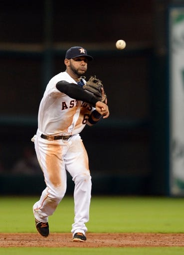 Sep 17, 2013; Houston, TX, USA; Houston Astros shortstop Jonathan Villar (6) throws out a runner against the Cincinnati Reds during the third inning at Minute Maid Park. Mandatory Credit: Thomas Campbell-USA TODAY Sports