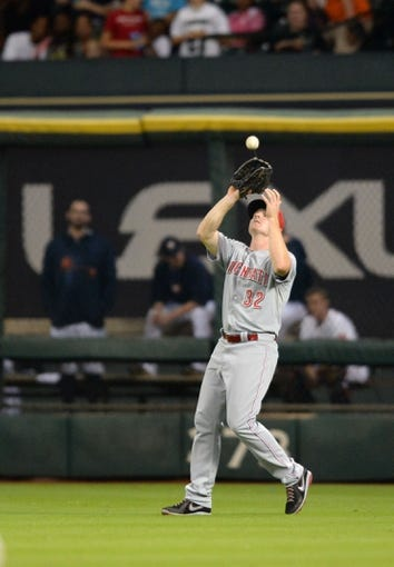 Sep 17, 2013; Houston, TX, USA; Cincinnati Reds right fielder Jay Bruce (32) catches a fly ball against the Houston Astros during the fourth inning at Minute Maid Park. Mandatory Credit: Thomas Campbell-USA TODAY Sports