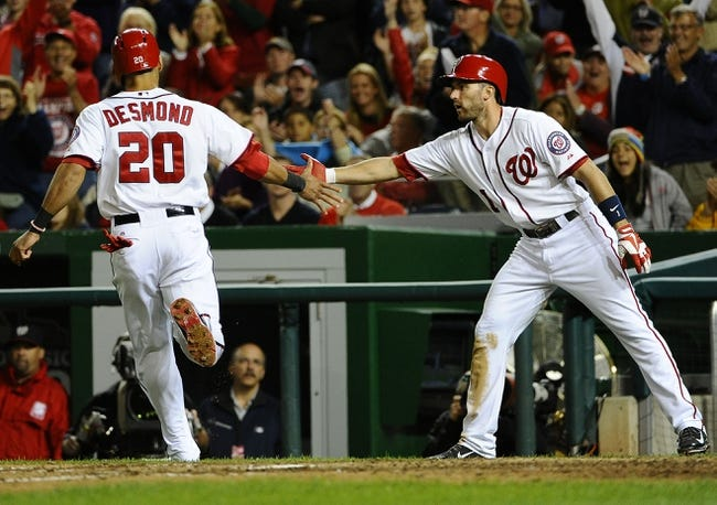 Sep 17, 2013; Washington, DC, USA; Washington Nationals shortstop Ian Desmond (20) is congratulated by second baseman Stephen Lombardozzi (1) after scoring a run against the Atlanta Braves during the eighth inning at Nationals Park. The Nationals won 4-0. Mandatory Credit: Brad Mills-USA TODAY Sports