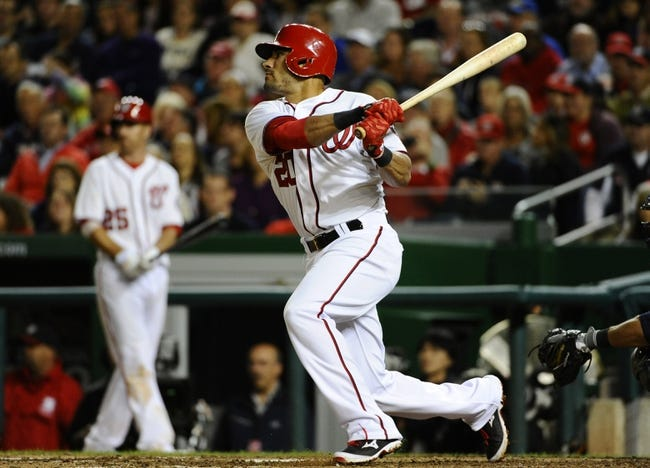 Sep 17, 2013; Washington, DC, USA; Washington Nationals shortstop Ian Desmond (20) hits an RBI double during the eighth inning against the Atlanta Braves at Nationals Park. The Nationals won 4-0. Mandatory Credit: Brad Mills-USA TODAY Sports