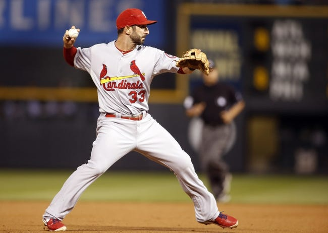 Sep 17, 2013; Denver, CO, USA; St. Louis Cardinals shortstop Daniel Descalso (33) fields a ground ball during the second inning against the Colorado Rockies at Coors Field. Mandatory Credit: Chris Humphreys-USA TODAY Sports