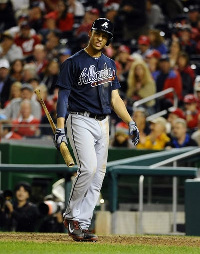 Sep 17, 2013; Washington, DC, USA; Atlanta Braves shortstop Andrelton Simmons (19) reacts after striking out against the Washington Nationals during the eighth inning at Nationals Park. The Nationals won 4 - 0. Mandatory Credit: Brad Mills-USA TODAY Sports