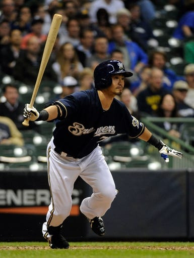 Sep 17, 2013; Milwaukee, WI, USA;   Milwaukee Brewers right fielder Norichika Aoki hits a triple in the sixth inning against the Chicago Cubs at Miller Park. Mandatory Credit: Benny Sieu-USA TODAY Sports
