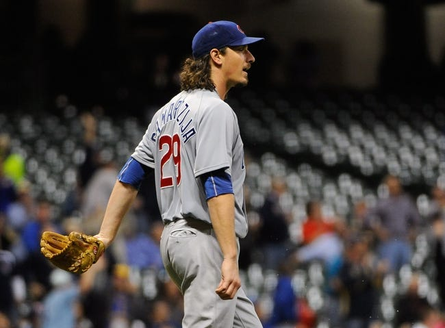Sep 17, 2013; Milwaukee, WI, USA;   Chicago Cubs pitcher Jeff Samardzija reacts after giving up a 2-run home run to Milwaukee Brewers center fielder Carlos Gomez (not pictured) in the seventh inning at Miller Park. Mandatory Credit: Benny Sieu-USA TODAY Sports