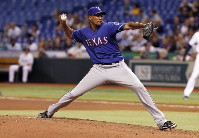 Sep 17, 2013; St. Petersburg, FL, USA; Texas Rangers starting pitcher Alexi Ogando (41) throws a pitch during the fourth inning against the Tampa Bay Rays at Tropicana Field. Texas Rangers defeated the Tampa Bay Rays 7-1. Mandatory Credit: Kim Klement-USA TODAY Sports