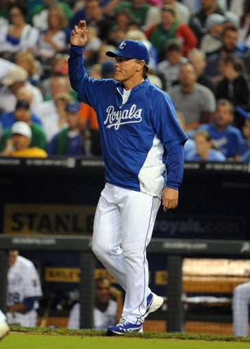 Sep 17, 2013; Kansas City, MO, USA; Kansas City Royals manager Ned Yost (3) makes pitching change against the Cleveland Indians in the sixth inning at Kauffman Stadium. Mandatory Credit: John Rieger-USA TODAY Sports