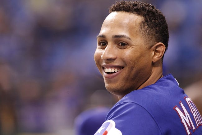 Sep 17, 2013; St. Petersburg, FL, USA; Texas Rangers center fielder Leonys Martin (2) stands in the dugout against the Tampa Bay Rays at Tropicana Field. The Rangers won 7-1. Mandatory Credit: Kim Klement-USA TODAY Sports