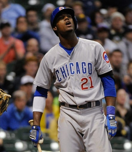 Sep 17, 2013; Milwaukee, WI, USA; Chicago Cubs left fielder Junior Lake (right) reacts after striking out in the eighth inning against the Milwaukee Brewers at Miller Park. Mandatory Credit: Benny Sieu-USA TODAY Sports