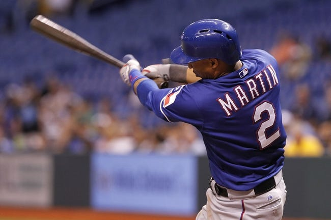 Sep 17, 2013; St. Petersburg, FL, USA; Texas Rangers center fielder Leonys Martin (2) hits a solo home run during the ninth inning against the Tampa Bay Rays at Tropicana Field. The Rangers won 7-1. Mandatory Credit: Kim Klement-USA TODAY Sports