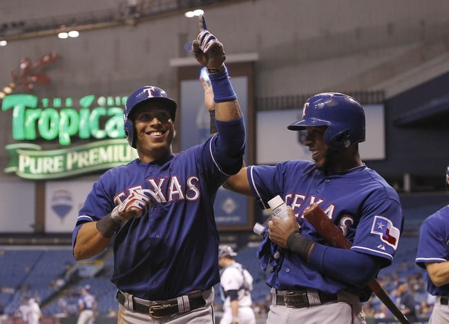 Sep 17, 2013; St. Petersburg, FL, USA; Texas Rangers center fielder Leonys Martin (2) is congratulated by shortstop Elvis Andrus (1) after hitting a solo home run during the ninth inning against the Tampa Bay Rays  at Tropicana Field. The Rangers won 7-1. Mandatory Credit: Kim Klement-USA TODAY Sports
