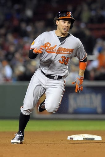 Sep 17, 2013; Boston, MA, USA; Baltimore Orioles designated hitter Danny Valencia (35) runs to third base after hitting a triple during the ninth inning against the Boston Red Sox at Fenway Park. Mandatory Credit: Bob DeChiara-USA TODAY Sports