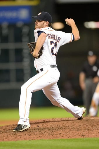 Sep 17, 2013; Houston, TX, USA; Houston Astros starting pitcher Philip Humber (21) pitches against the Cincinnati Reds during the seventh inning at Minute Maid Park. The Reds won 10-0. Mandatory Credit: Thomas Campbell-USA TODAY Sports