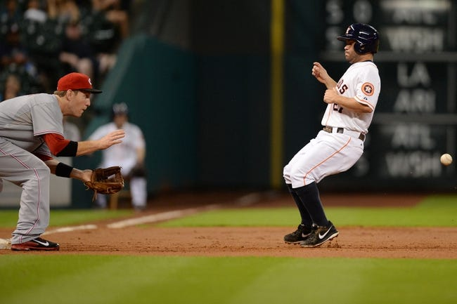Sep 17, 2013; Houston, TX, USA; Houston Astros second baseman Jose Altuve (27) races the ball to third base against the Cincinnati Reds during the first inning at Minute Maid Park. Mandatory Credit: Thomas Campbell-USA TODAY Sports