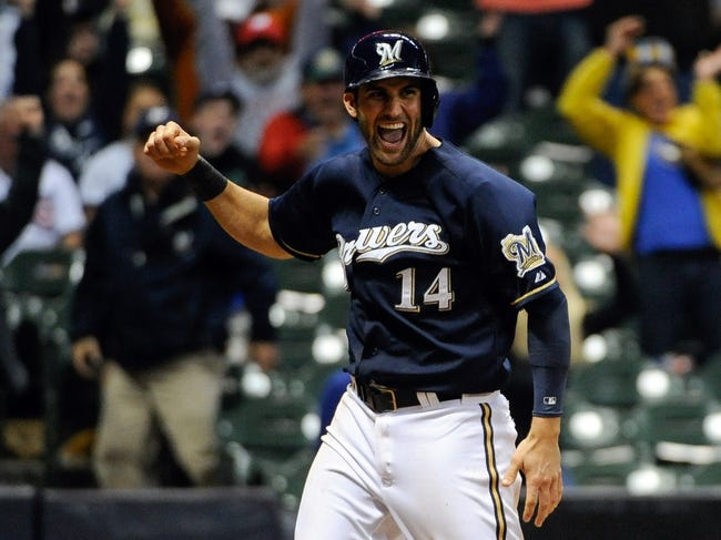 Sep 17, 2013; Milwaukee, WI, USA;  Milwaukee Brewers third baseman Jeff Bianchi celebrates after scoring the winning run on a suicide squeeze in the ninth inning against the Chicago Cubs at Miller Park. Mandatory Credit: Benny Sieu-USA TODAY Sports