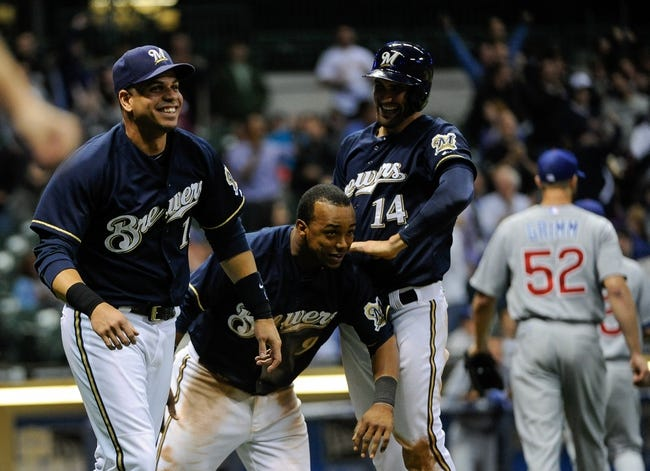 Sep 17, 2013; Milwaukee, WI, USA;   Milwaukee Brewers third baseman Aramis Ramirez, shortstop Jean Segura and third baseman Jeff Bianchi celebrate after beating the Chicago Cubs 4-3 at Miller Park. Mandatory Credit: Benny Sieu-USA TODAY Sports