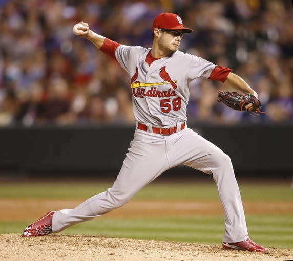 Sep 17, 2013; Denver, CO, USA; St. Louis Cardinals starting pitcher Joe Kelly (58) delivers a pitch during the fifth inning against the Colorado Rockies at Coors Field. Mandatory Credit: Chris Humphreys-USA TODAY Sports