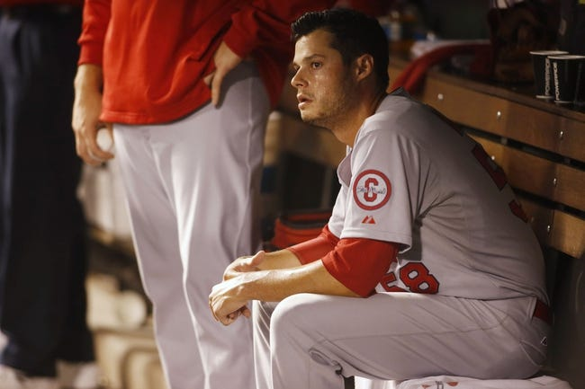 Sep 17, 2013; Denver, CO, USA; St. Louis Cardinals starting pitcher Joe Kelly (58) watches from the dugout during the sixth inning against the Colorado Rockies at Coors Field. Mandatory Credit: Chris Humphreys-USA TODAY Sports