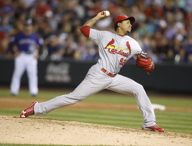 Sep 17, 2013; Denver, CO, USA; St. Louis Cardinals pitcher Carlos Martinez (62) delivers a pitch during the sixth inning against the Colorado Rockies at Coors Field. Mandatory Credit: Chris Humphreys-USA TODAY Sports
