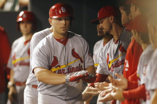 Sep 17, 2013; Denver, CO, USA; St. Louis Cardinals left fielder Matt Holiday (7) is greeted by teammates in the dugout after hitting a home run during the fifth inning against the Colorado Rockies at Coors Field. Mandatory Credit: Chris Humphreys-USA TODAY Sports