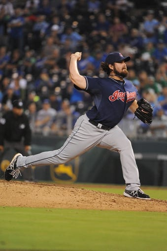 Sep 17, 2013; Kansas City, MO, USA; Cleveland Indians relief pitcher Chris Perez (54) delivers a pitch in the ninth inning against the Kansas City Royals at Kauffman Stadium. The Indians won 5-3. Mandatory Credit: John Rieger-USA TODAY Sports