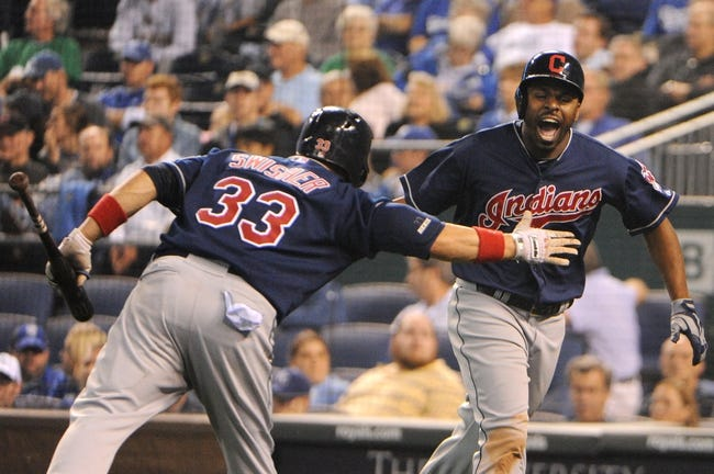 Sep 17, 2013; Kansas City, MO, USA; Cleveland Indians center fielder Michael Bourn (24) is congratulated by first baseman Nick Swisher (33) after hitting a home run in the ninth inning against the Kansas City Royals at Kauffman Stadium. The Indians won 5-3. Mandatory Credit: John Rieger-USA TODAY Sports