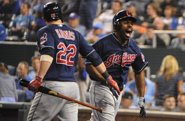 Sep 17, 2013; Kansas City, MO, USA; Cleveland Indians center fielder Michael Bourn (24) is congratulated by second baseman Jason Kipnis (22) after hitting a home run in the ninth inning against the Kansas City Royals at Kauffman Stadium. The Indians won 5-3. Mandatory Credit: John Rieger-USA TODAY Sports