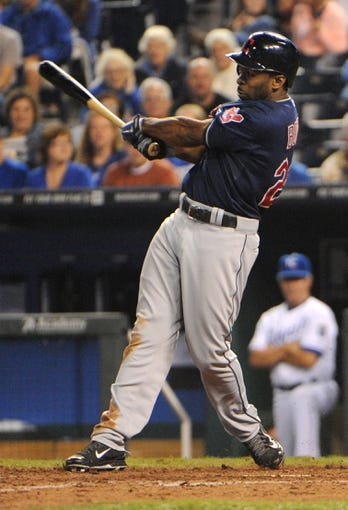 Sep 17, 2013; Kansas City, MO, USA; Cleveland Indians center fielder Michael Bourn (24) hits a home run in the ninth inning against the Kansas City Royals at Kauffman Stadium. The Indians won 5-3. Mandatory Credit: John Rieger-USA TODAY Sports