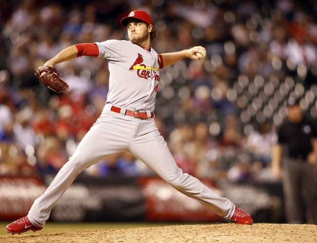 Sep 17, 2013; Denver, CO, USA; St. Louis Cardinals pitcher Kevin Siegrist (46) delivers a pitch during the eighth inning against the Colorado Rockies at Coors Field. The Cardinals won 11-4.  Mandatory Credit: Chris Humphreys-USA TODAY Sports