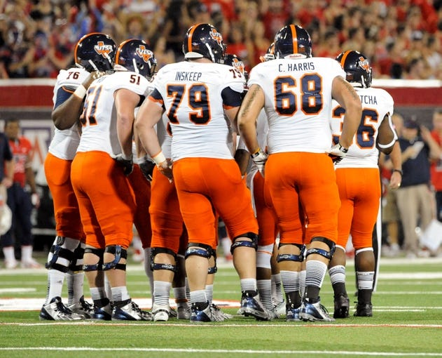 Sep 14, 2013; Tucson, AZ, USA; Texas-San Antonio Roadrunners offensive tackle Josh Walker (76) offensive guard Payton Rion (51) offensive guard Scott Inskeep (79) and offensive tackle Cody Harris (68) huddle up with teammates during the first quarter against the Arizona Wildcats at Arizona Stadium. The Wildcats defeated the Roadrunners 38-13. Mandatory Credit: Casey Sapio-USA TODAY Sports