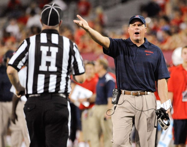 Sep 14, 2013; Tucson, AZ, USA; Arizona Wildcats head coach Rich Rodriguez disagrees with a call during the fourth quarter against the Texas-San Antonio Roadrunners at Arizona Stadium. The Wildcats defeated the Roadrunners 38-13. Mandatory Credit: Casey Sapio-USA TODAY Sports