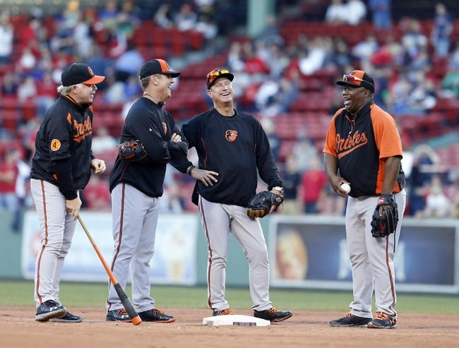 Sep 18, 2013; Boston, MA, USA; (From right) Baltimore Orioles first base coach Wayne Kirby (23), bench coach John Russell (77), third base coach Bobby Dickerson (11) and manager Buck Showalter (26) on the field before the start of the game against the Boston Red Sox at Fenway Park. Mandatory Credit: David Butler II-USA TODAY Sports