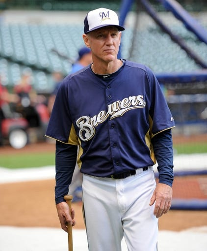 Sep 18, 2013; Milwaukee, WI, USA;  Milwaukee Brewers manager Ron Roenicke watches batting practice before game against the Chicago Cubs at Miller Park. Mandatory Credit: Benny Sieu-USA TODAY Sports