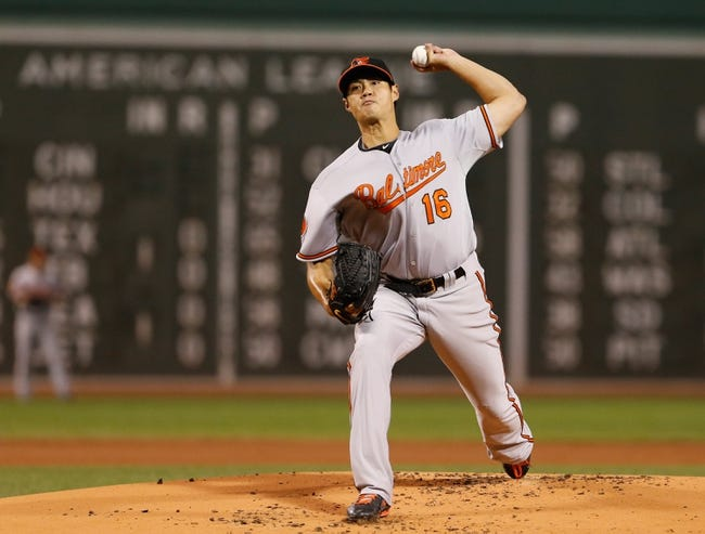 Sep 18, 2013; Boston, MA, USA; Baltimore Orioles starting pitcher Wei-Yin Chen (16) throws a pitch against the Boston Red Sox in the first inning at Fenway Park. Mandatory Credit: David Butler II-USA TODAY Sports