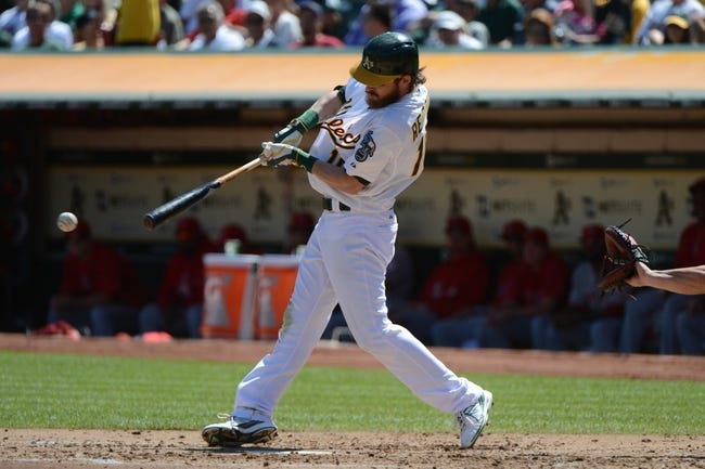 September 18, 2013; Oakland, CA, USA; Oakland Athletics right fielder Josh Reddick (16) hits a single against the Los Angeles Angels during the third inning at O.co Coliseum. Mandatory Credit: Kyle Terada-USA TODAY Sports