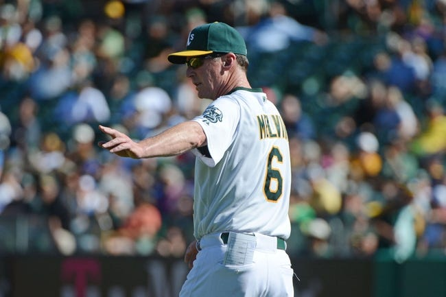 September 18, 2013; Oakland, CA, USA; Oakland Athletics manager Bob Melvin (6) signals for a pitching change against the Los Angeles Angels during the 11th inning at O.co Coliseum. The Angels defeated the Athletics 5-4 in 11 innings. Mandatory Credit: Kyle Terada-USA TODAY Sports