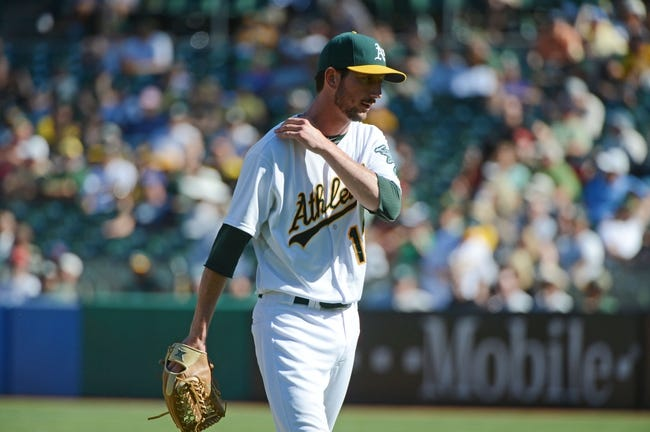 September 18, 2013; Oakland, CA, USA; Oakland Athletics relief pitcher Jerry Blevins (13) walks to the dugout in a pitching change against the Los Angeles Angels during the 11th inning at O.co Coliseum. The Angels defeated the Athletics 5-4 in 11 innings. Mandatory Credit: Kyle Terada-USA TODAY Sports