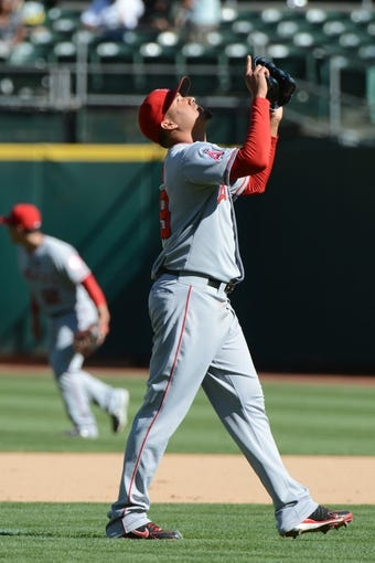 September 18, 2013; Oakland, CA, USA; Los Angeles Angels relief pitcher Ernesto Frieri (49) celebrates after the game against the Oakland Athletics at O.co Coliseum. The Angels defeated the Athletics 5-4 in 11 innings. Mandatory Credit: Kyle Terada-USA TODAY Sports