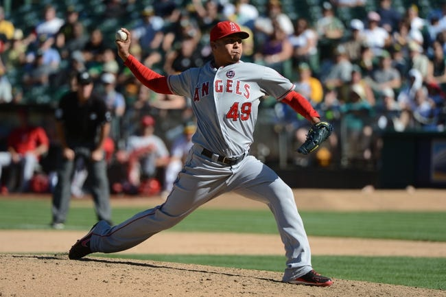 September 18, 2013; Oakland, CA, USA; Los Angeles Angels relief pitcher Ernesto Frieri (49) delivers a pitch against the Oakland Athletics during the 11th inning at O.co Coliseum. The Angels defeated the Athletics 5-4 in 11 innings. Mandatory Credit: Kyle Terada-USA TODAY Sports