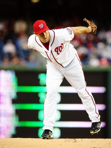 Sep 18, 2013; Washington, DC, USA; Washington Nationals pitcher Ross Ohlendorf (43) throws a pitch in the first inning against the Atlanta Braves at Nationals Park. Mandatory Credit: Evan Habeeb-USA TODAY Sports