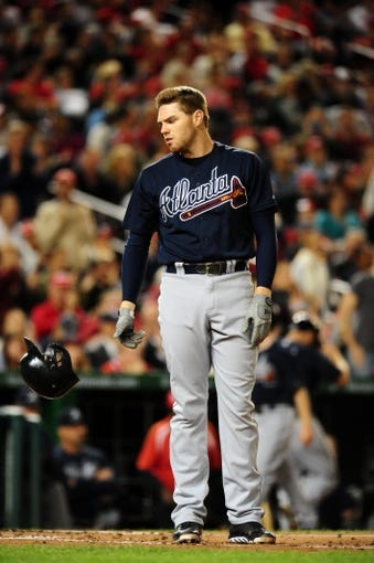 Sep 18, 2013; Washington, DC, USA; Atlanta Braves first baseman Freddie Freeman (5) reacts after lining into a double play in the fourth inning against the Washington Nationals at Nationals Park. Mandatory Credit: Evan Habeeb-USA TODAY Sports